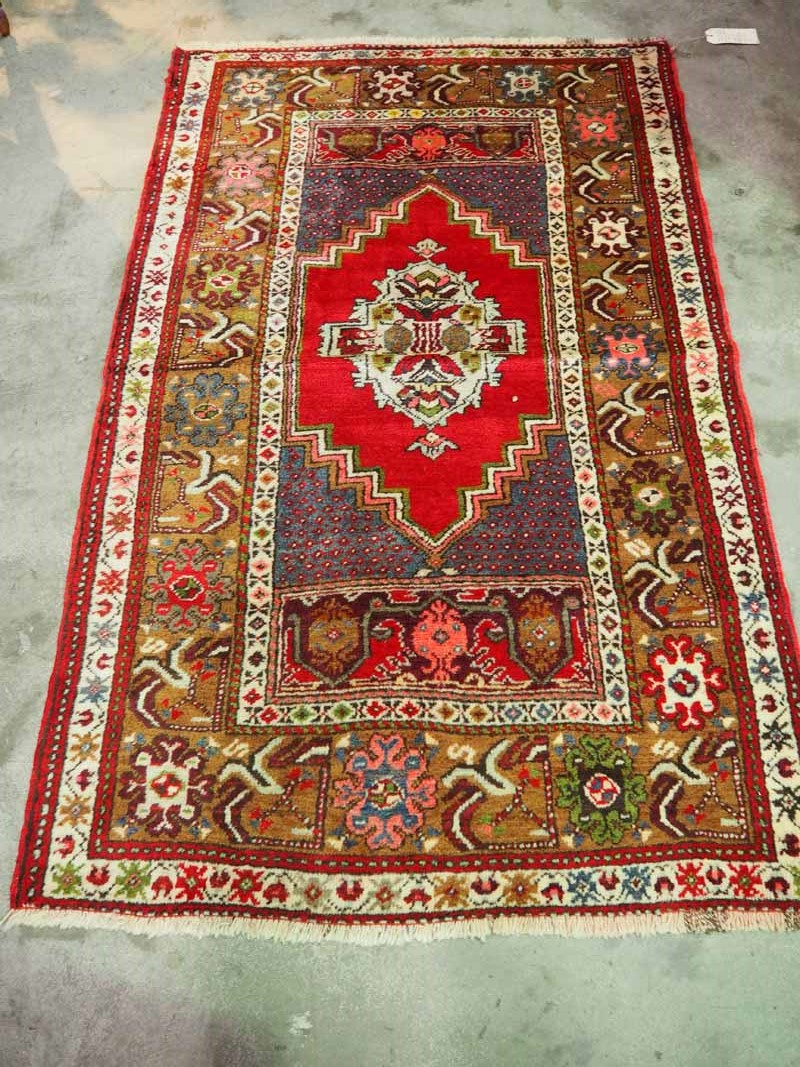 Wool on wool double knotted Turkish carpet from Kirsehir. Approximately 100 years old.