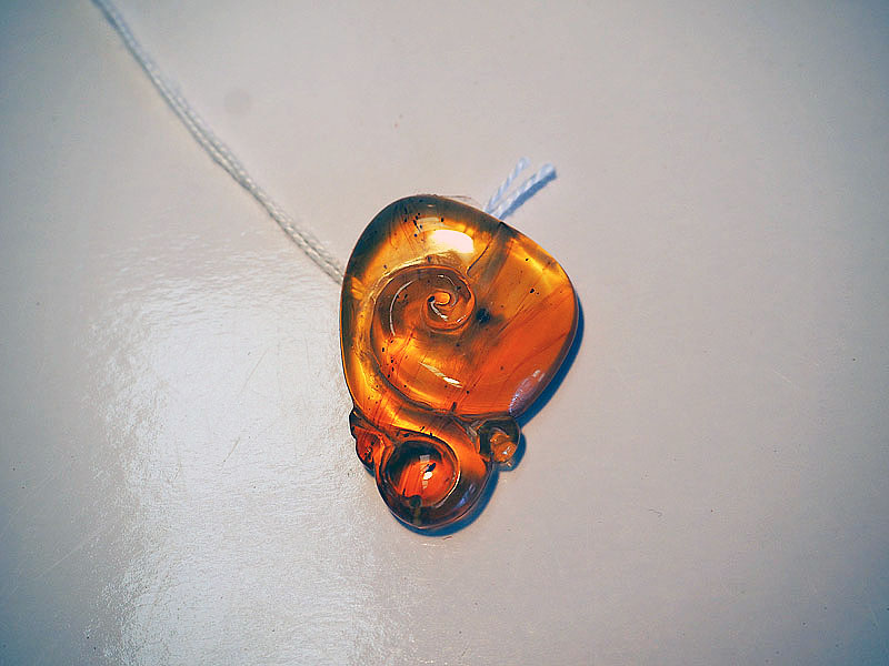 "Carved Burmese ""Pocket"" amber"