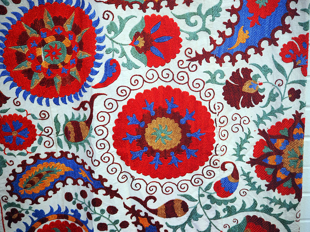 Silk embroidered cotton backed suzani from Uzbekistan. (Queen Size)