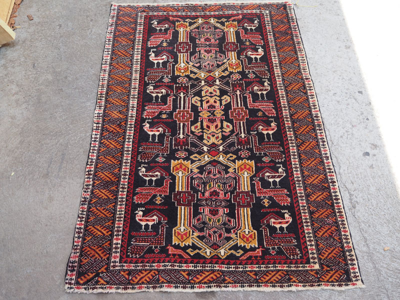 Hand knotted wool on wool Belouch carpet, approximately 50 years old