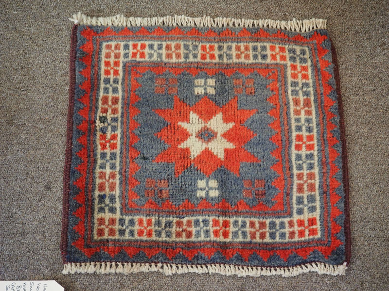 Hand knotted wool on wool small table mat from Bergama, approximately 30 years old